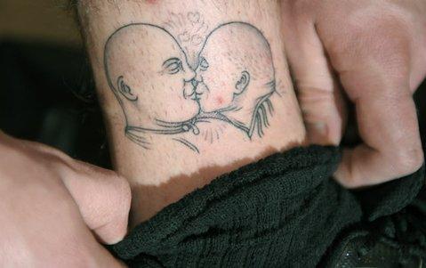Emmet Bentley's tattoo of Barkley kissing NBA referee Dick Bavetta.