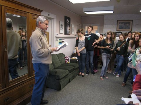 Randall Vandermey, English department chair at Westmont College, reading C. S. Lewis writings in front of the famous wardrobe