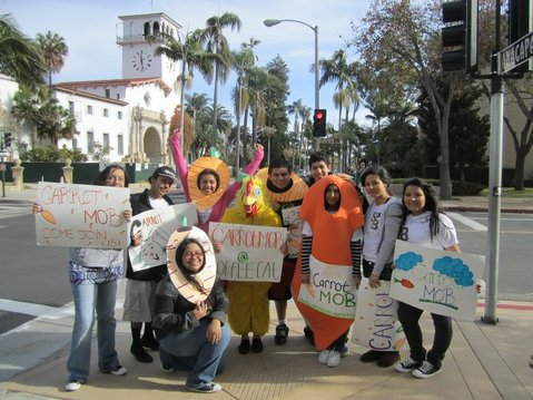 Santa Barbara High School students from Dons Net Café advertising the Carrot Mob in front of  Coffee Cat on the corner of Anacapa and Anapamu streets
