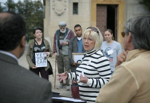 "<strong>PEEPING THE POWER:</strong>  Retired banker Candace Jones speaks at a <a href=""http://MoveOn.org"">MoveOn.org</a> press conference on January 19, urging the federal government to investigate foreclosure-related bank fraud."