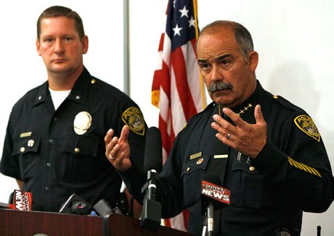 <strong>'VERY TRAGIC AND UNFORTUNATE SITUATION':</strong>  Santa Maria Police Chief Danny Macagni (right) talks to the press about Saturday morning's shooting of Officer Albert Covarrubias, killed by fellow officer and friend Matt Kline.