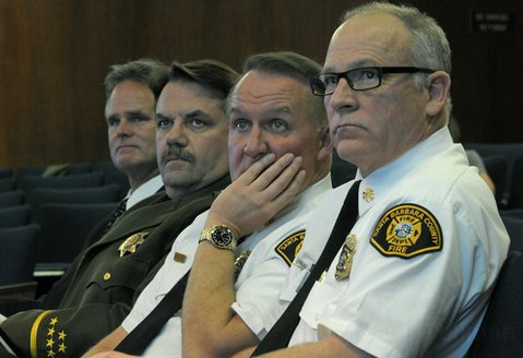 <strong>FLIGHT OF THE CONCORD:</strong> Sheriff Bill Brown (second from left) and County Fire Chief Michael Dyer (second from right) meet before the supervisors to discuss how to consolidate power over the county's five helicopters.