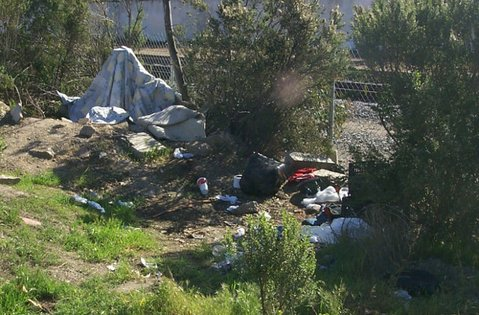 Homeless campsite near the creek bed at the corner of Calle Cesar Chavez and the railroad tracks.