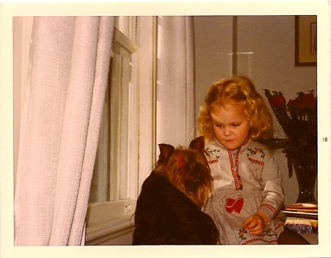 Laura as a child, talking to Taffy