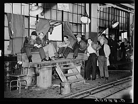 Flint, Michigan, 1936: Strikers guarding window to Fisher body plant number three.
