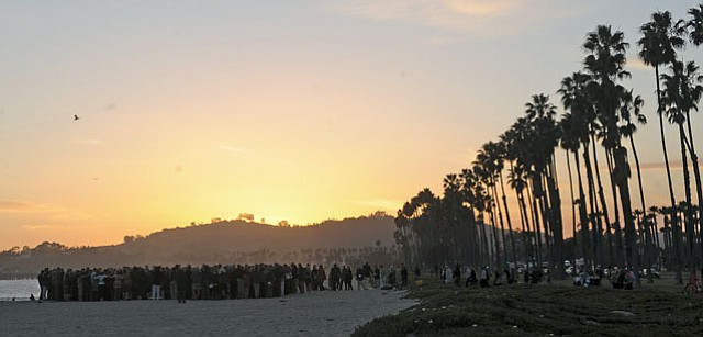 Following Mike deGruy's memorial service on Sunday friends and family gathered on the beach for a small ceremony as the sun set Feb. 12, 2012