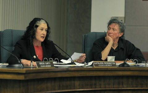 "<strong>Defense from the Dais:</strong>  Kathleen Reddington (left) accused fellow councilmembers of conducting a ""witch hunt"" against Joe Armendariz, while Mayor Al Clark (right) insisted Armendariz violated the council's code of ethics."
