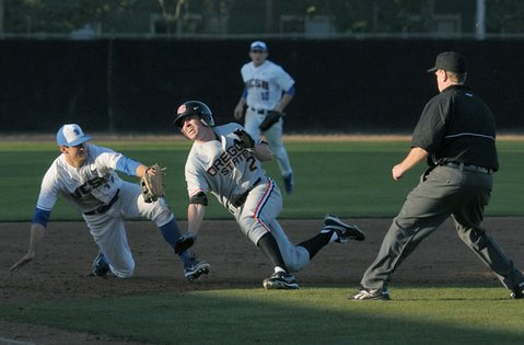Oregon State baserunner Ryan Dunn, trying to advance to third, is about to be tagged out by UCSB's Ryan Palermo.
