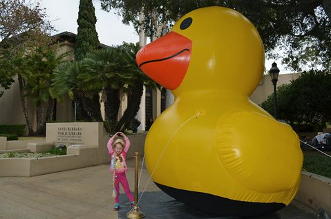 Kiana Sneathen stands in front of a 15-foot-tall inflatable duck that visited the Santa Barbara Library as part of a promotional tour for Donovan Hohn's book, Moby Duck.