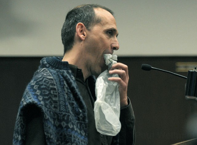 <strong>CHOKED UP:</strong>  Ordinance proponent Isaac Hernández stuffs a plastic bag in his mouth as he addresses the council, imitating the marine life that dies from ingesting such litter.