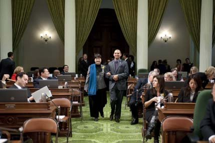 """Assemblyman Das Williams escorts human Rights Activist from Santa Barbra, Dr. Victoria Riskin, during a special floor ceremony Monday at the State Capitol honoring California's """"Women of the Year."""""""
