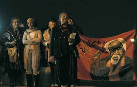 Poet and activist Sojourner Kincaid Rolle speaks at a candlelight vigil for Babatunde Folayemi, Sunday April 1, 2012