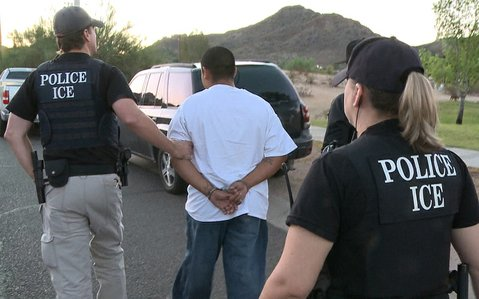 ICE agents make an arrest during the September 2011 Cross Check operation