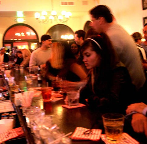 Lively scene at a restaurant and bar in the heart of Santa Barbara's entertainment district.
