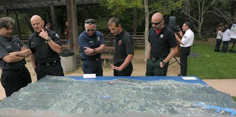 Firefighters study a model of the South Coast during a briefing held by the Fire Chiefs Association of Santa Barbara (May 2, 2012)