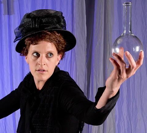 <em>Piezoelectric Love: The (half) Life of Marie Curie</em>