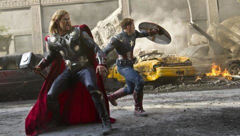 Chris Hemsworth (left) and Chris Evans take up hammer and shield as Thor and Captain America, respectively, in Marvel's pre-summer smash hit <em>The Avengers</em>.