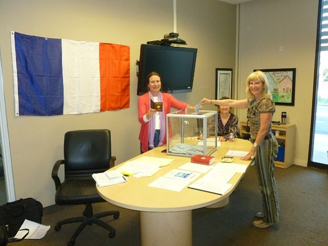 Prudential real estate agent Pascale Bassan (left) hosts polling site for the French presidential election