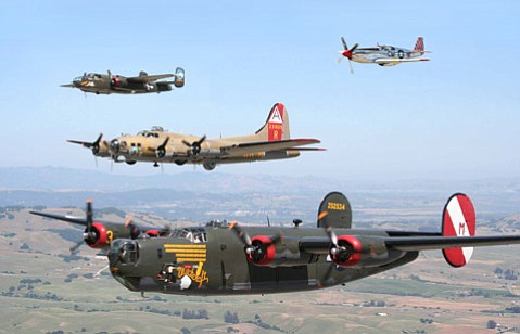 Bottom to top: B-24, B-17, B-25, and P-51 in formation.