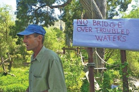 Alan Road resident Dan McCarter speaks out against the proposed bridge in Measure Y
