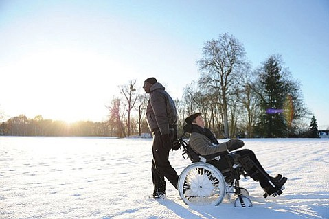 A brusque Senegalese immigrant (Omar Sys) and affluent paralyzed Frenchman (François Cluzet) form a winning odd couple in <em>The Intouchables</em>.