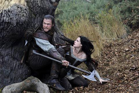 Kristen (<em>Twilight)</em> Stewart and Chris (<em>Thor</em>) Hemsworth star as the title characters in the revisionist <em>Snow White and the Hunstman</em>.