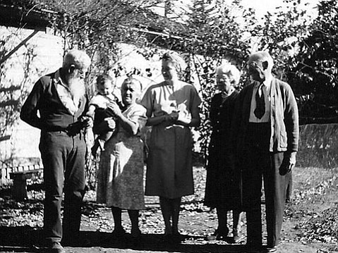 """The Jones clan circa 1952 (left to right): Clarence Mead """"CM"""" and Magdalena Jones with grandson Robert, daughter Doris Mae Jones, and CM's sister and brother-in-law Grace and Ira Hendricks stand in front of the family's Edison Street home."""