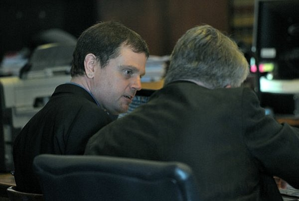 Kenneth Barber (pictured) talks with his attorney Joe Allen in court Friday (June 6, 2012)