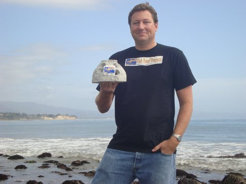 Chris Goldblatt with scale model of reef ball.