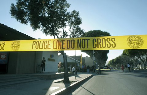 Police tape blocks a section of Milpas street as the SWAT team responds to reports of a barricaded woman with a handgun