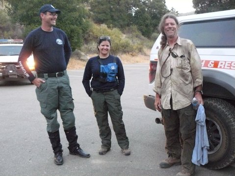 Search and Rescue volunteers with formerly missing hiker Dan McCaslin (right).