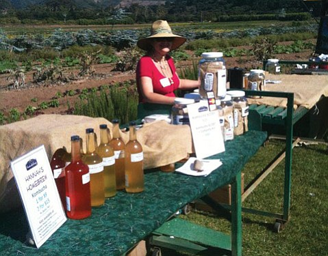 Hannah Crum, the Kombucha Mamma, shows off her fermented wares at the 2011 Fermentation Festival.