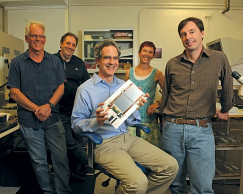 from left:  Engineer Dean White, physicists Claudio Campagnari and Jeff Richman, engineer Susanne Kyre, and physicist David Stuart posed with a UCSB silicon detector similar to those that helped capture images of the Higgs boson.