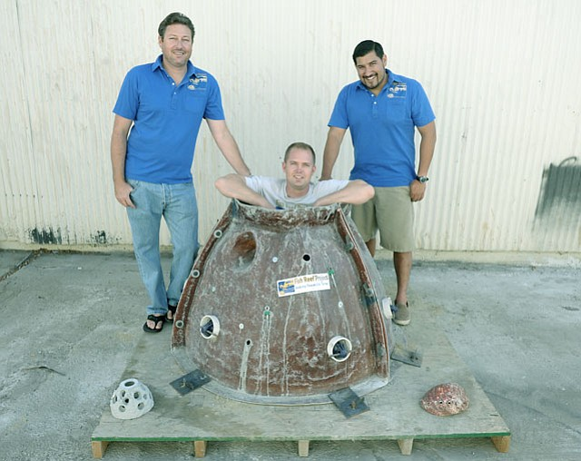 "<strong>REEF BUILDERS 'R' US:</strong>  (from left) Chris Goldblatt, Lonnie Nelson, and Tony Huerta pose with the form used to make concrete ""reef balls,"" a key ingredient in the artificial reef that their group, Fish Reef Project, hopes to build offshore of Santa Barbara."