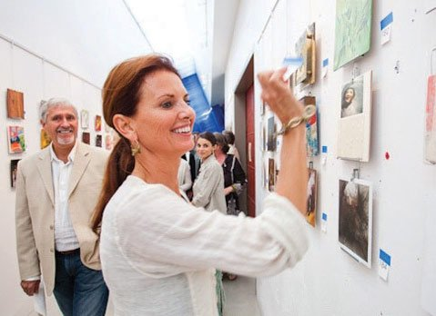 Artist Erika Carter makes a purchase at the 2011 <em>One Night Stand</em>.