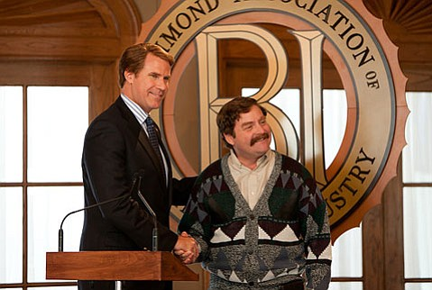 Will Ferrell (left) stars as a congressmember whose seat is challenged by a naïve adversary (Zach Galifianakis) in the lackluster political satire <em>The Campaign</em>.