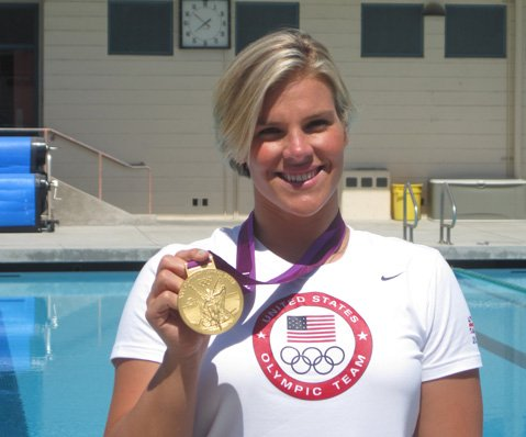 Kami Craig displays her Olympic gold medal next to Santa Barbara High School's pool.
