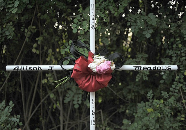 A memorial marks the site where Allison Meadows was killed June 6 in a car surfing accident on East Valley Road (September 4, 2012)