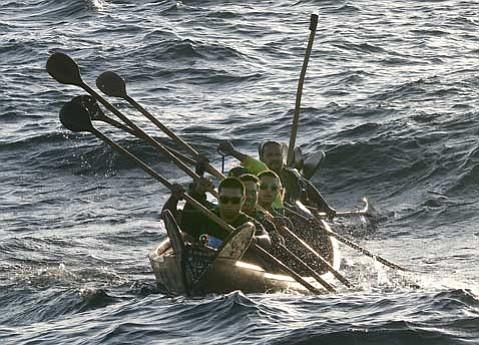 Tomol crossing paddlers