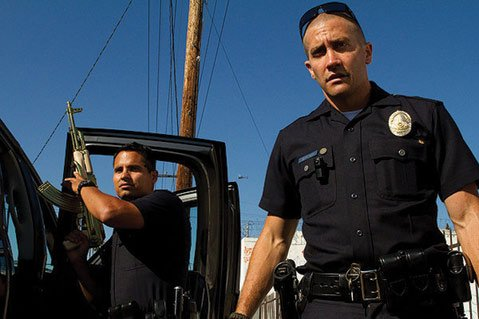 The shaky-cam cop drama <i>End of Watch</i> stars Jake Gyllenhaal (right) and Michael Peña as LAPD partners who engage in glib squad-car repartee and inadvertently make a bust that attracts the attention of a ruthless Mexican cartel.