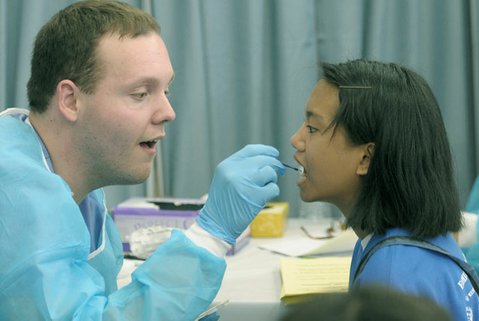 Amazing Grace Llanos gets a fluoride treatment from dental student Charles Woodward Jr.