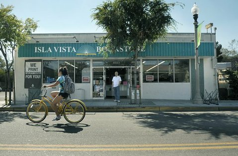 Dennis Tokumaru stands in the doorway of Isla Vista Bookstore