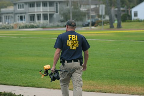 FBI agents search the scene were Christopher Marks's body was found two weeks ago (October 3, 2012)