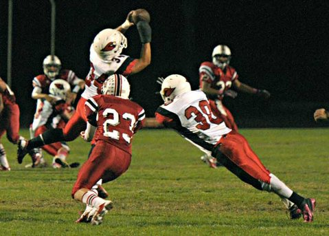 Bishop's Christian Pearson (34) leaps high to intercept a pass.