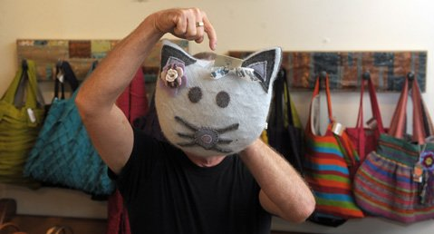 Half writer, half cat, author D.J. Palladino is (un?)masked at Plum Goods.