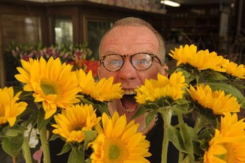 Man (author D.J. Palladino) meets flower at Victor the Florist.