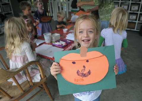 The circumference of a pumpkin can be math and art at Discoveries Learning Center, as Kelsey Row, age 41⁄2, demonstrates.