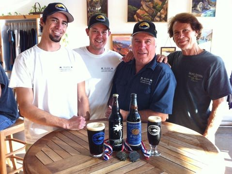 Island&#39;s Ryan Morrill (left), Shaun Crowley, owner Paul Wright, and Bill Geldreich
