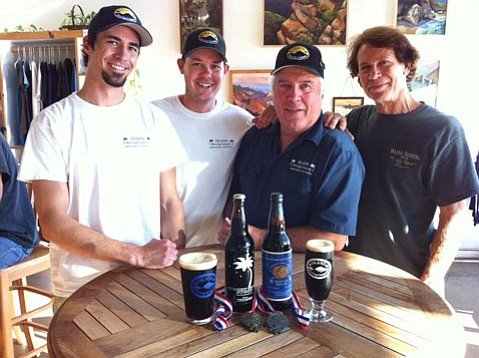 Island's Ryan Morrill (left), Shaun Crowley, owner Paul Wright, and Bill Geldreich
