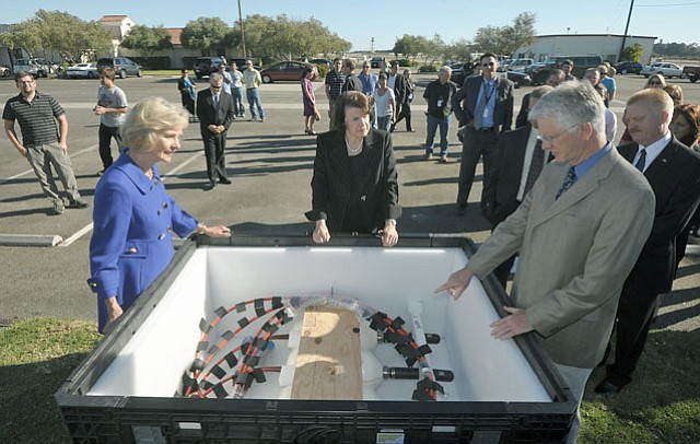 L3 MariPro Project Manager Tom Phillips (right) displays one of the company's hydrophones to Congresswoman Lois Capps and Senator Dianne Feinstein (Oct. 26, 2012)